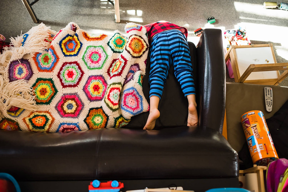 Documentary photography, child playing on couch, philadelphia
