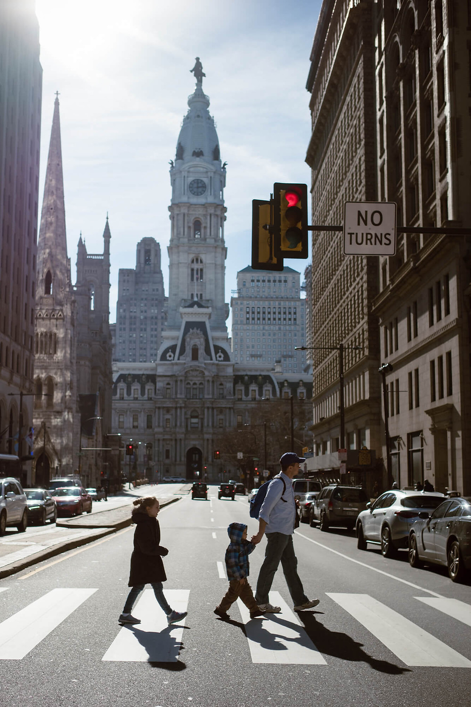 Family crossing broad street in philadelphia