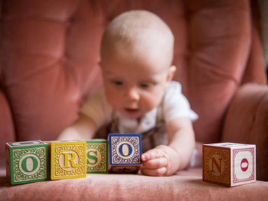 boy playing with wodden blocks