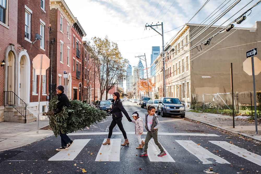 Philadelphia family walking a tree across a city street