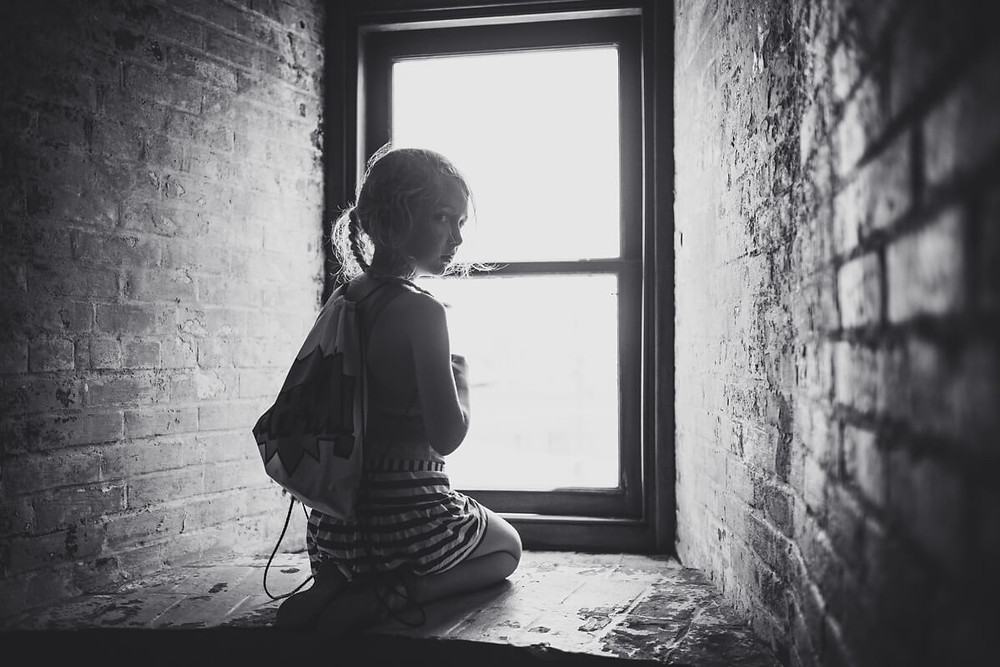 Child looking out the window at Absecon Lighthouse