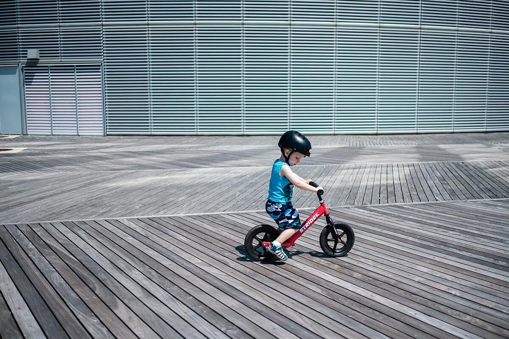 Child riding bike on the boardwalk in Atlantic City