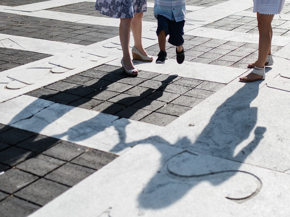 kid jumping with shadows