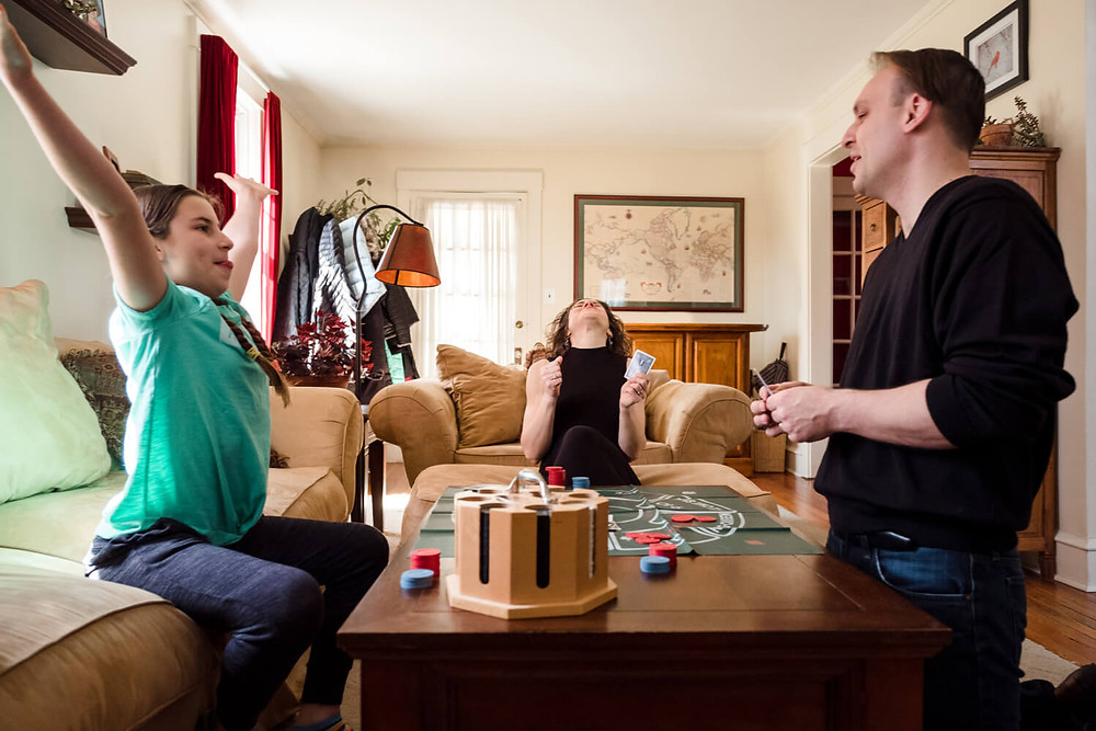 Documentary photography, family playing a board game, philadelphia