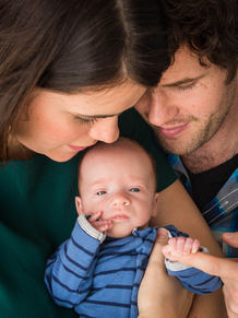 parents holding newborn baby