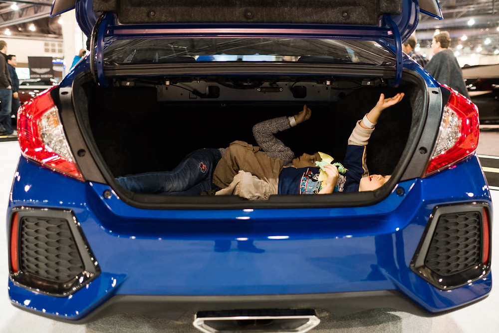 kids in trunk at the Philadelphia Auto Show