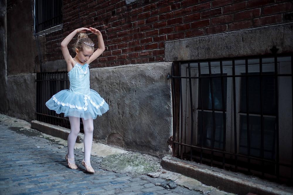 ballerina dancing in alley