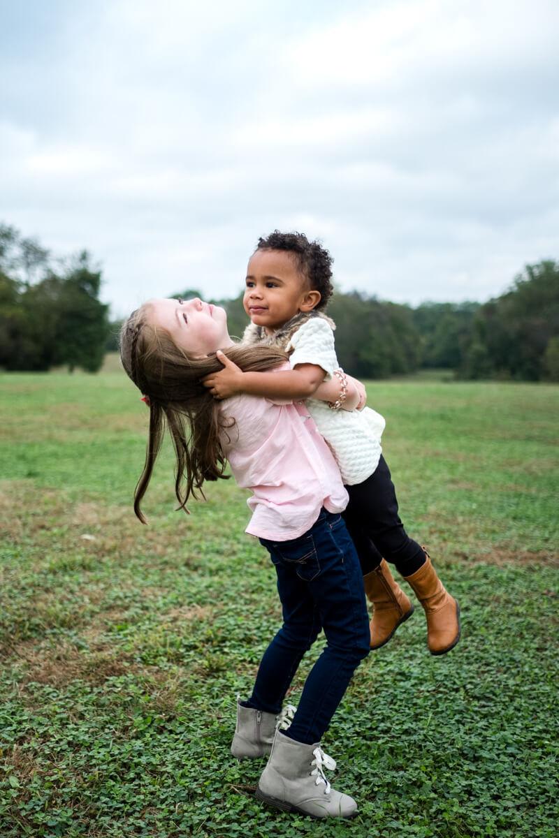 big sister holding little sister