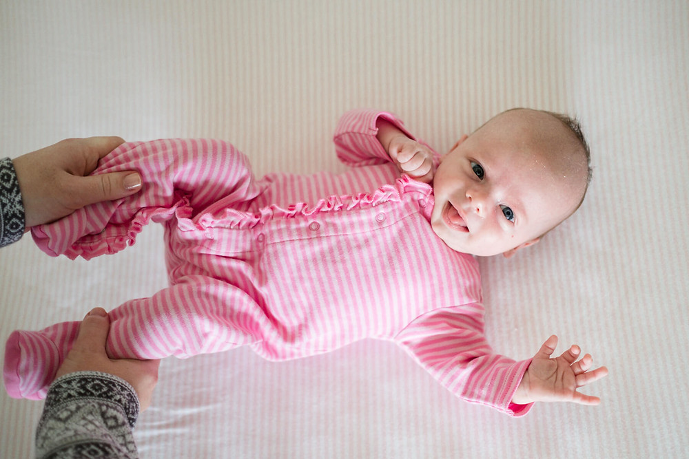 happy baby in pink pajamas