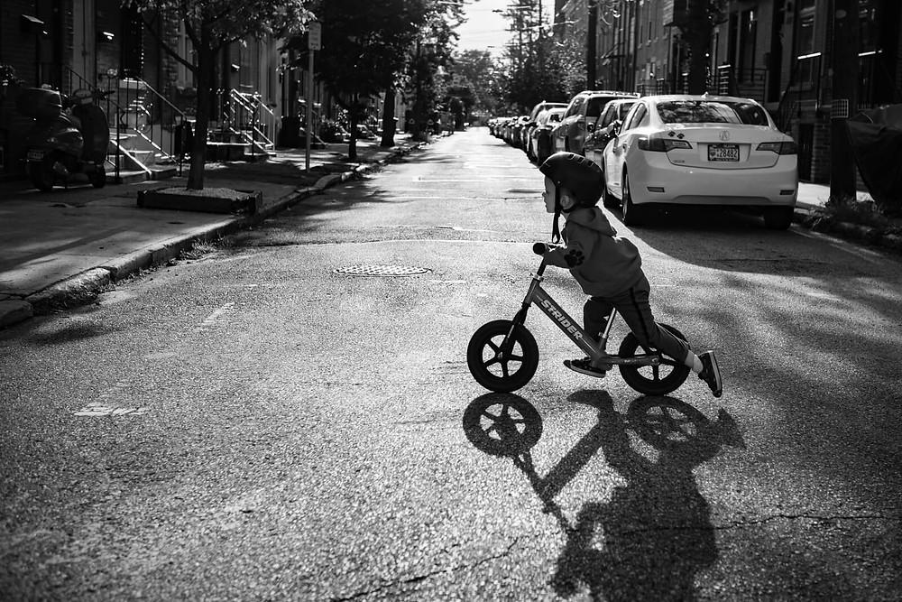 boy on balance bike in brewerytown