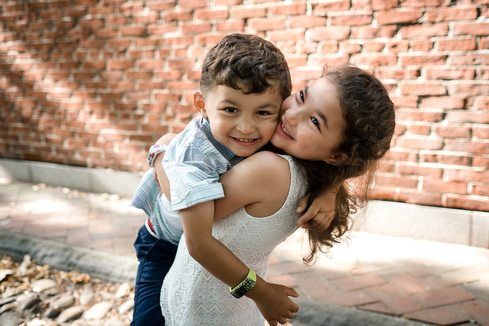 Children hugging in old city philadelphia