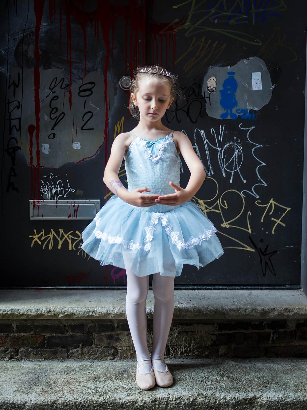ballerina in front of graffiti