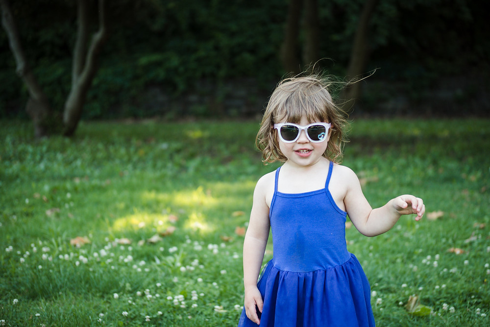 little girl with sun glasses