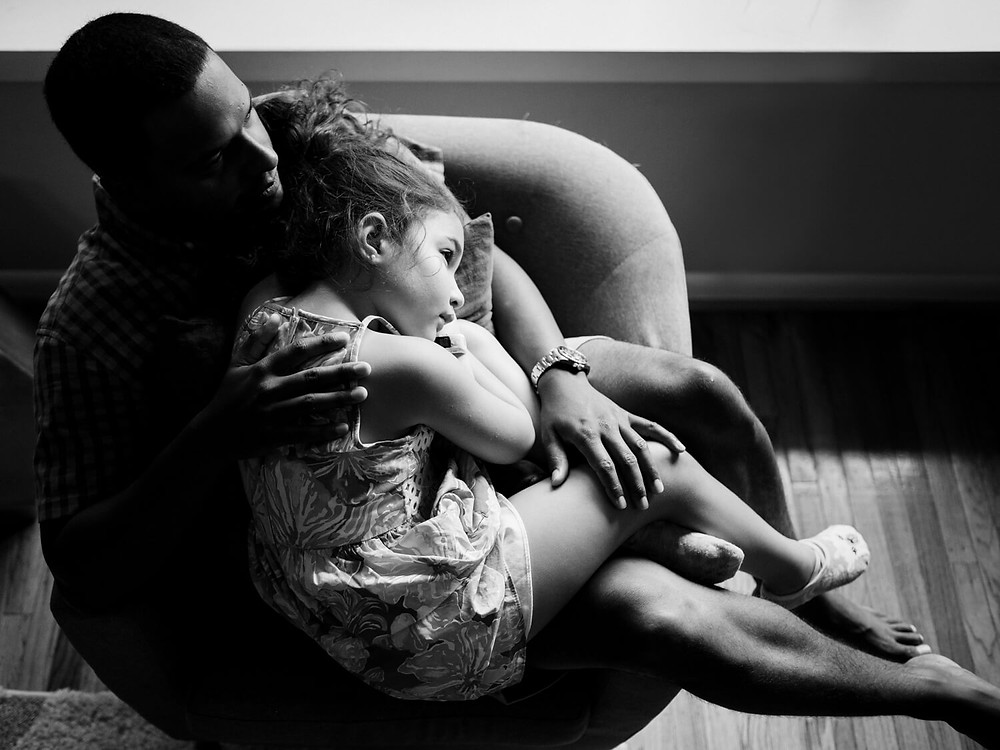 Documentary photography, Father and daughter cuddling, philadelphia, black and white