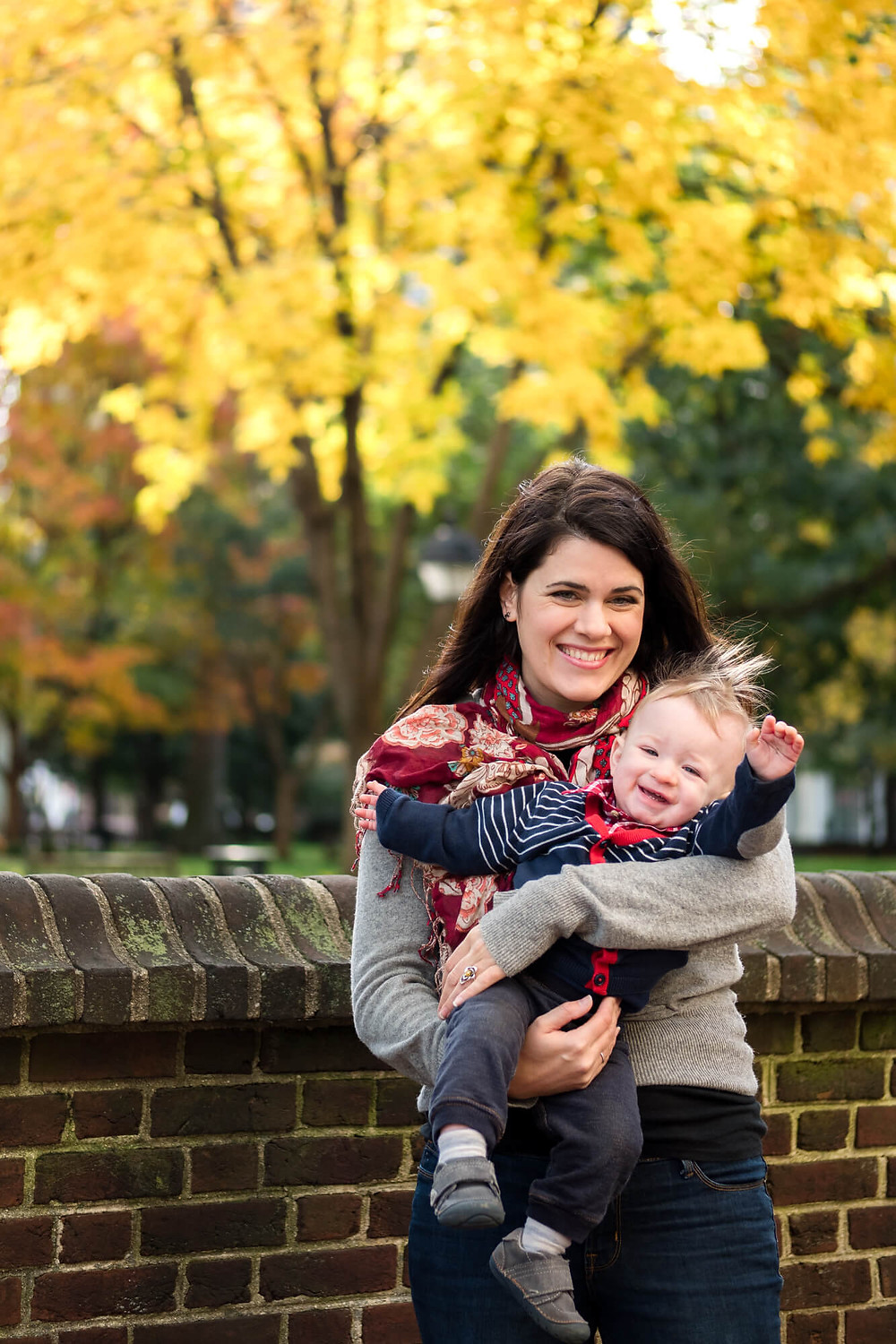 toddler and mom at washington square in the fall