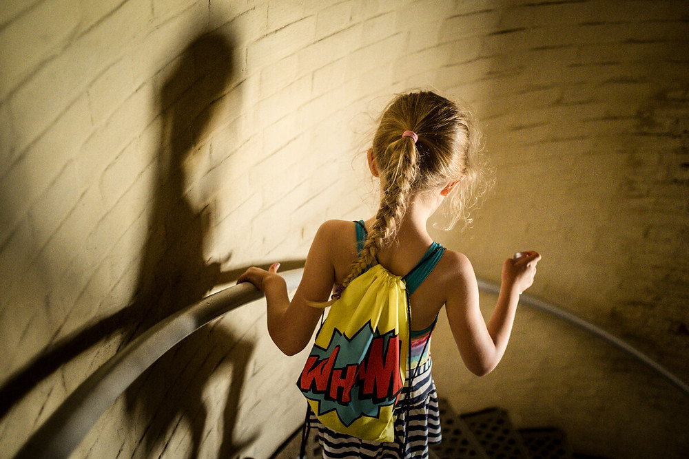 Child walking down stairs of Absecon Lighthouse