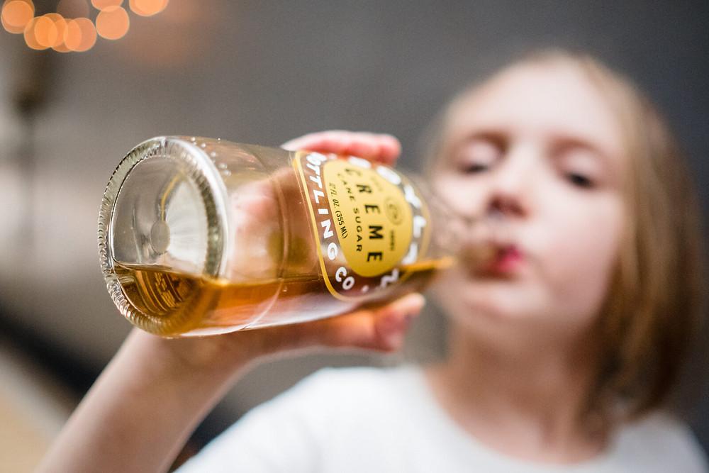 girl drinking soda at rybrew