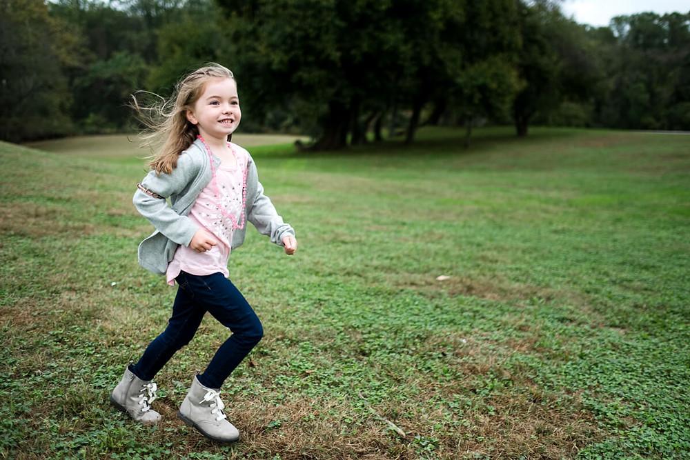 girl running at Rose Tree Park