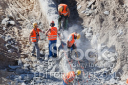 stock-photo-21001544-steel-workers-at-construction-site_edited.jpg