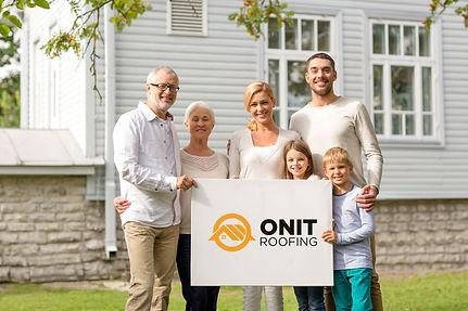 Family Holding Sign.jpg