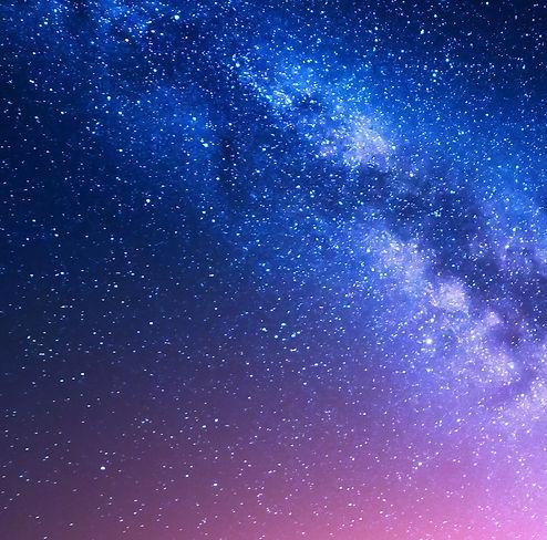 Woman doing yoga under the stars.jpg