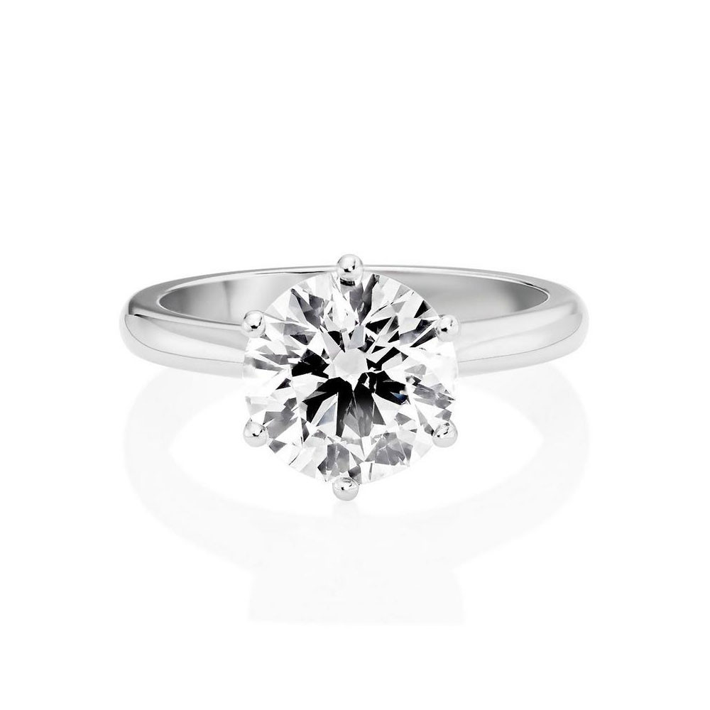 Temple and Grace Round Brilliant Cut Engagement Ring In A Six Claw Setting