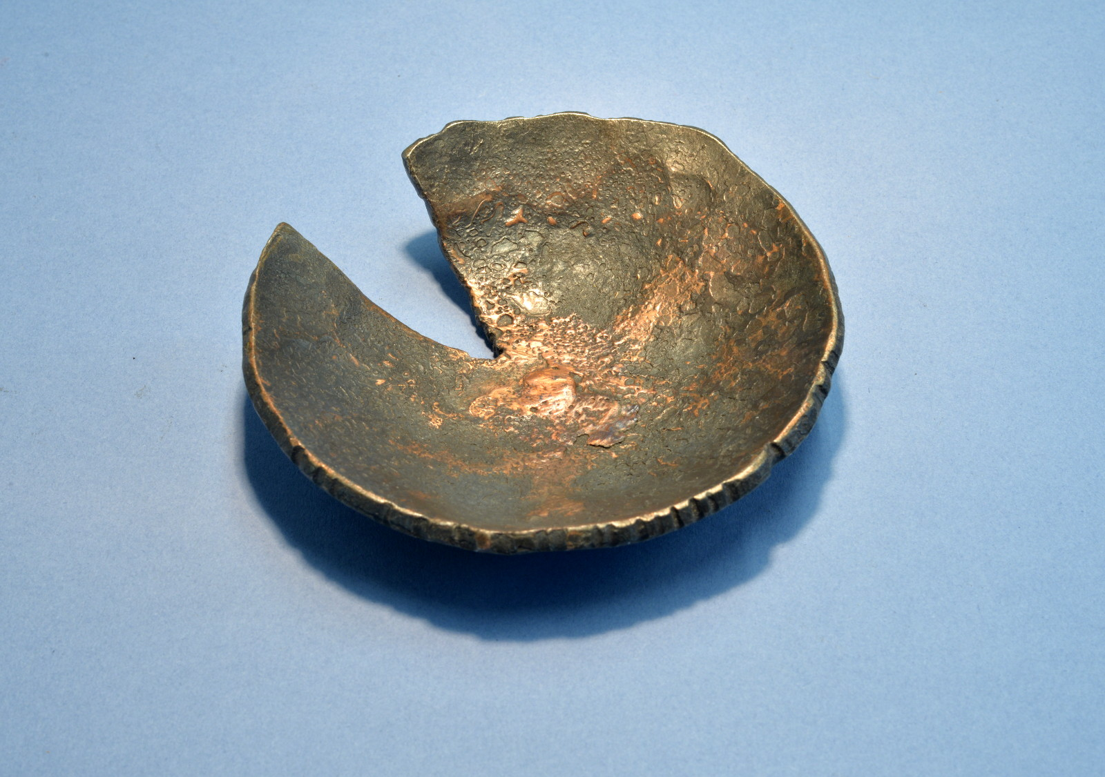 Small hammered iron and copper bowl
