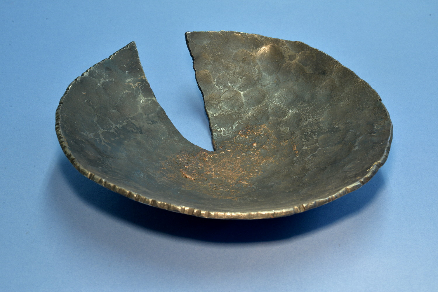 Large hammered iron and copper bowl