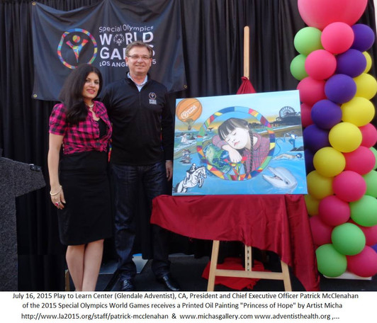 13 Special Olympics CEO World Games Patrick McClenahan receives painting by micha with Glendale Adventist Hospital.jpg