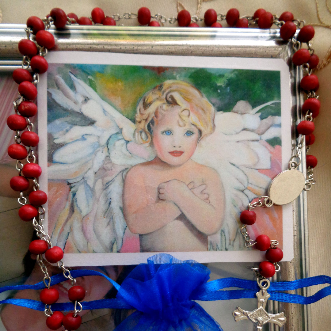 red rosary, prayer card, incense,..