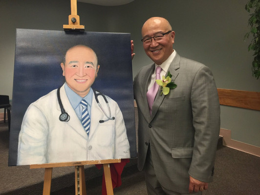 Dr Lew and his painting.jpg
