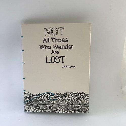 Not All Who Wander Are Lost Tolkien quote מחברת כריכה קשה, ציטוט של טולקין, איור של ים בשילוב רקמה