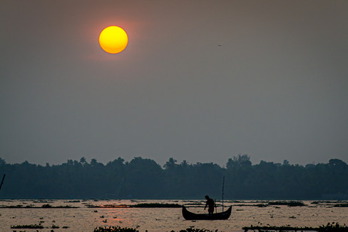 Sinking sun with Fisherman