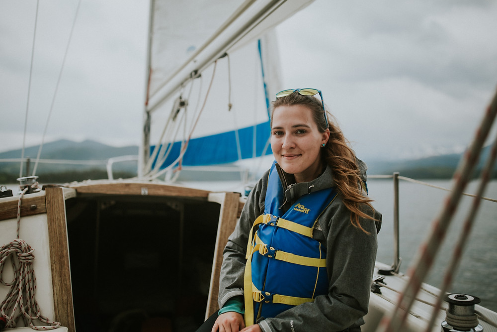 sailing on Lake Dillon with a life jacket for safety