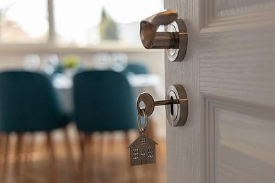 Open door to a new home. Door handle wit