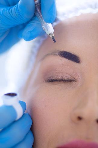 Permanent makeup for eyebrows. Closeup o