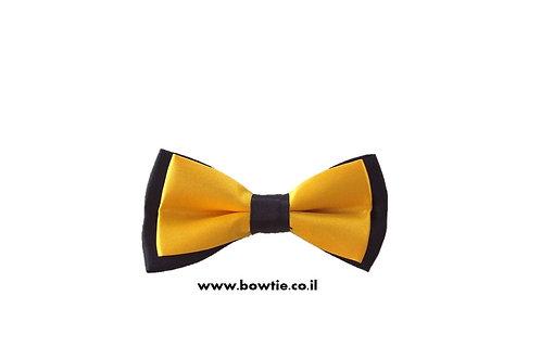 עניבת פפיון צהובה רקע שחור