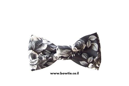 עניבת פפיון דמוי עור שחור לבן פרחים