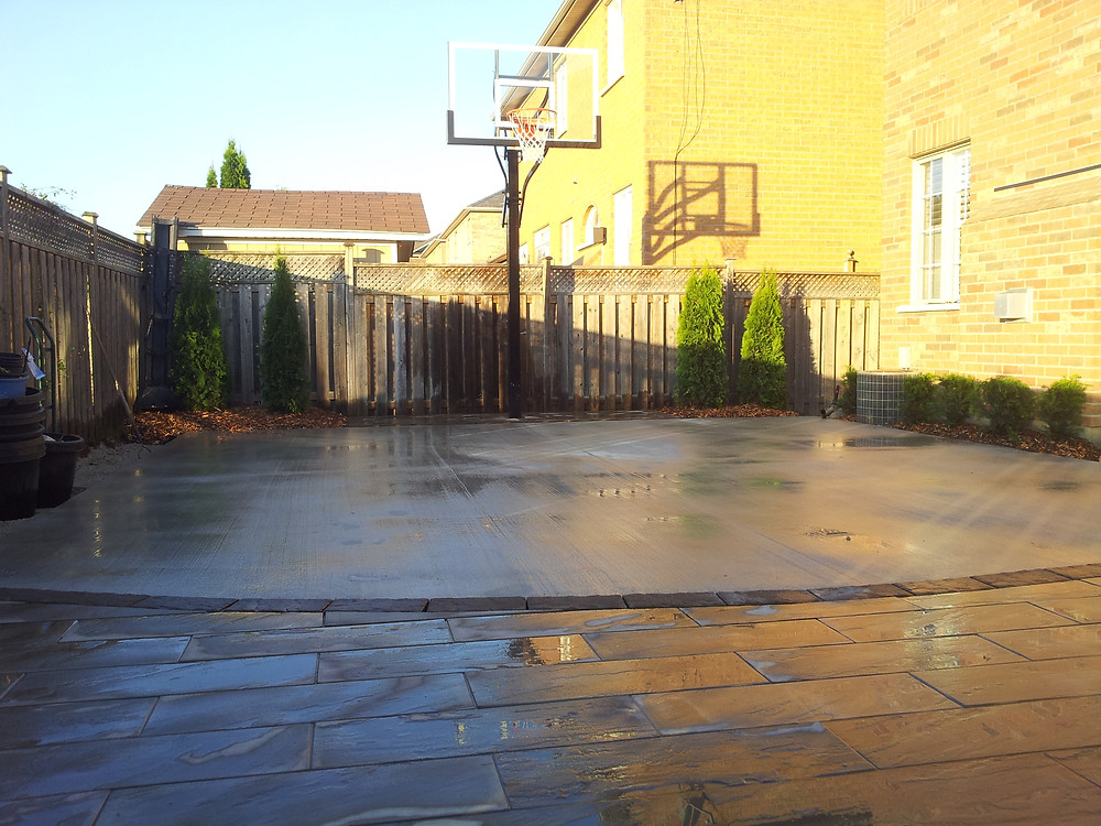 Basketball sport court in backyard, installed by Omni Landscaping