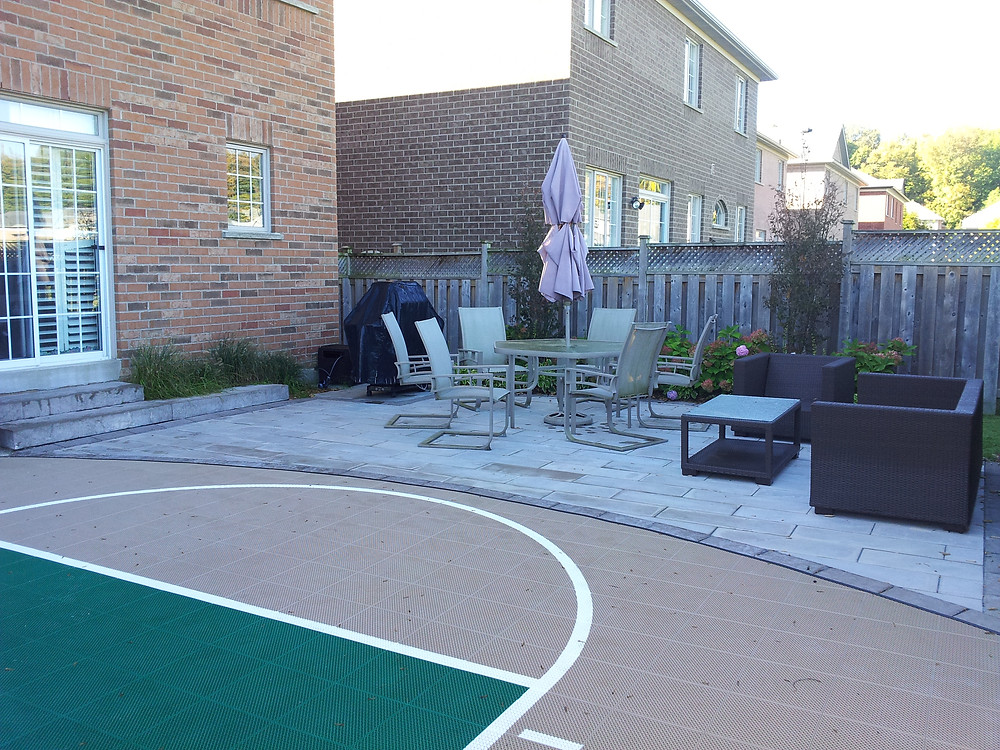 Basketball sport court with patio, installed by Omni Landscaping