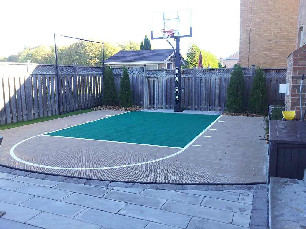 Basketball sport court installed by Omni Landscaping
