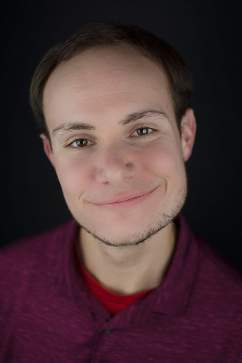 A headshot where Brian Pappas is smiling