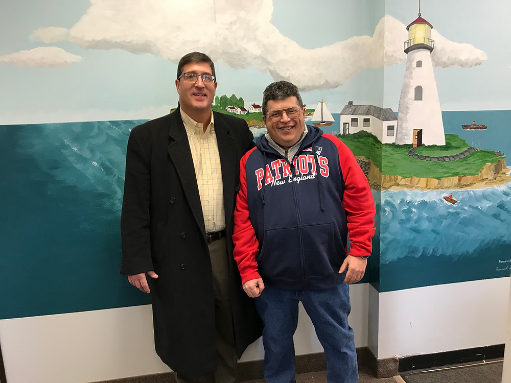 Mike Maloni (right) stands with Patrick Carnevale, Director of the Governor's Western Massachusetts Office in Springfield, when he came to visit Springfield's Lighthouse clubhouse in February 2019.
