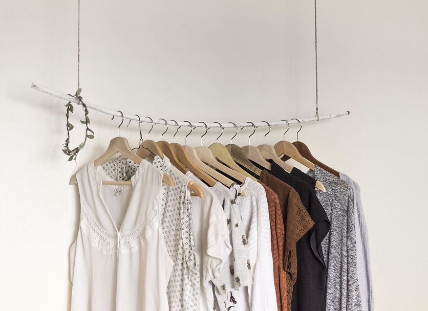 Canva - Women's Clothes Hanging on a Rac