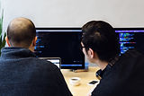 programmers-reviewing-code-on-computer.j