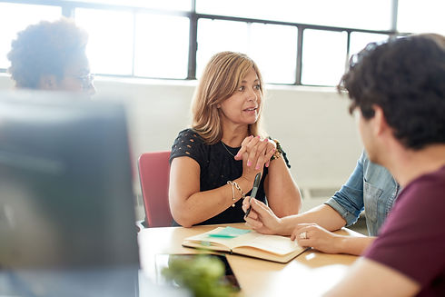 Mediator resolving conflict in a meeting.