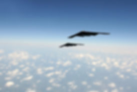 Two modern stealth bombers flying at hig