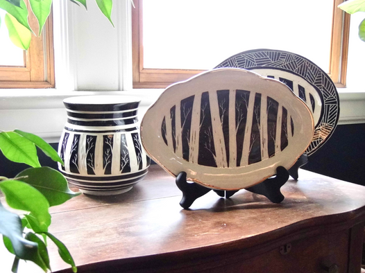White sgraffito platters and vase on marbled clay