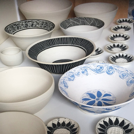 Bowls and ginger grates fresh out of the kiln and ready to be glazed for the last firing