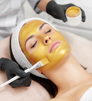 Hands of cosmetology specialist applying